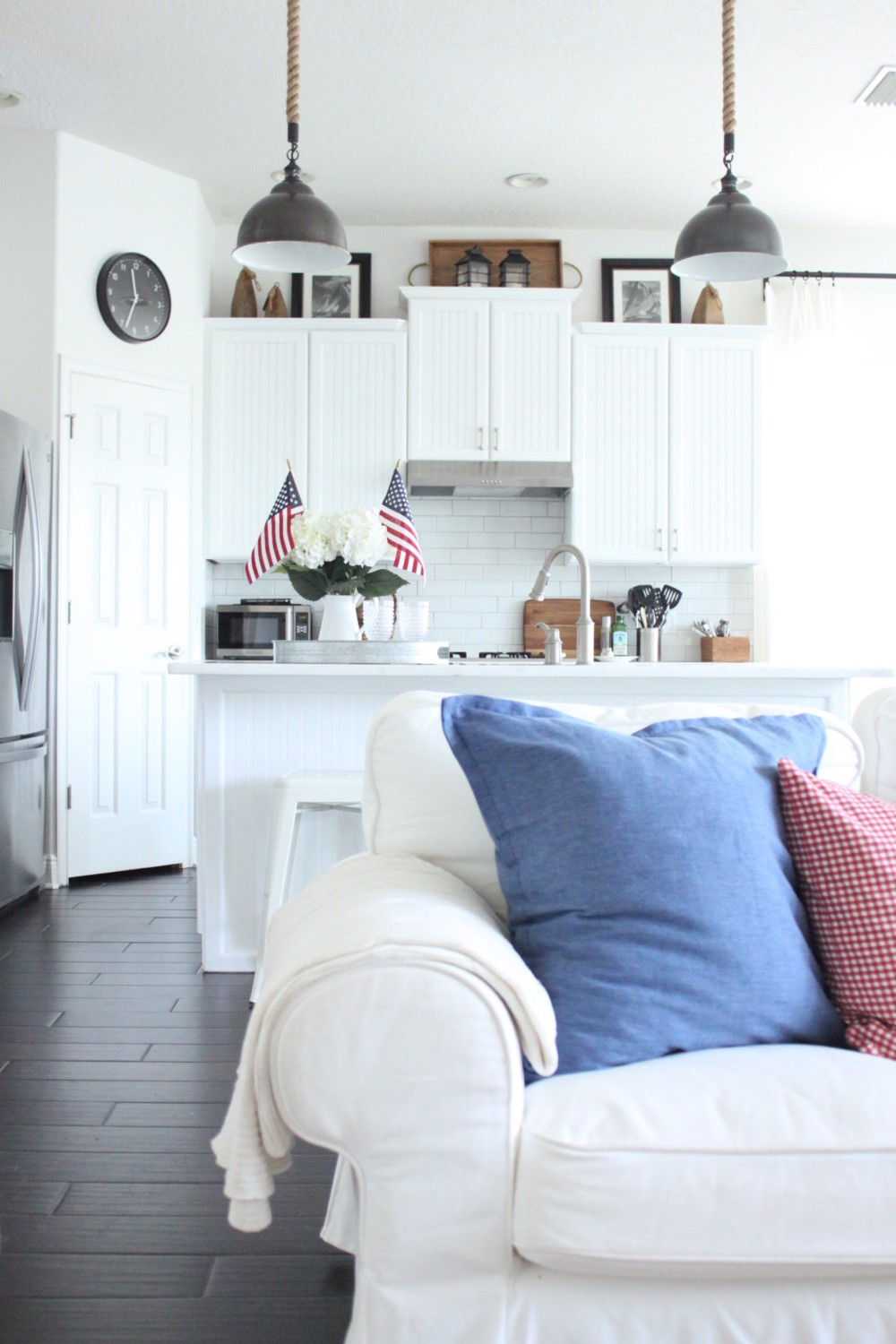 Patriotic kitchen - A Simple White Pitcher Filled With Flowers And Flags Is The Perfect Patriotic Touch