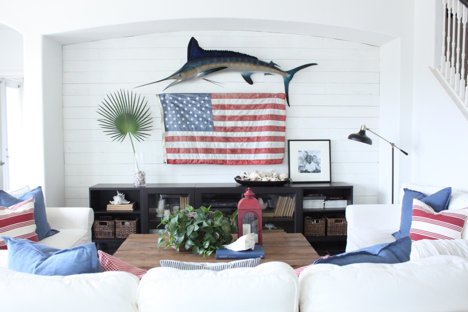 red white and blue decor for the family room starfish cottage i love adding fun colors and accessories to the cottage and this month was really fun i decided to hang a large vintage flag over our large flat screen tv